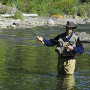 picture of a man fly fishing in a stream near Grand Marais MN
