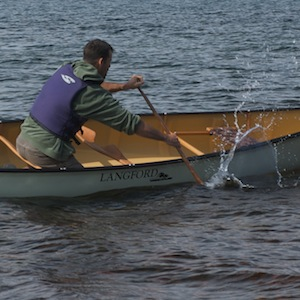 Picture of a man paddling a Langford canoe