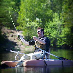 Picture of a man fly fishing from a kick boat