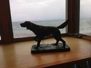 Sculpture of dog sitting on a desk in Stone Harbor Wilderness Supply, Grand Marais, Minnesota