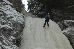 Ice climbing on a frozen waterfall