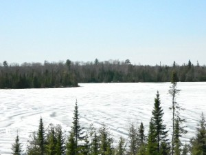 Picture of Poplar Lake along the Gunflint Trail. You can see lots of snow on the lake.