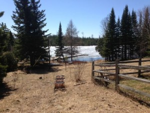 Picture of Poplar Lake taken from the Trail Center front yard. There is quite a bit of snow on the lake.
