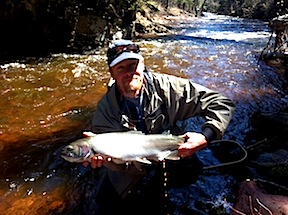 Picture of Scott holding a Steelhead fish