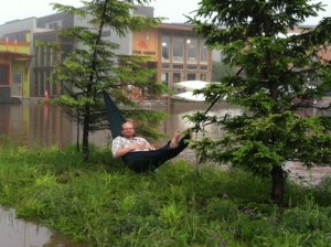 Picture of Jacob relaxing in a hammock on an island in the otherwise flooded Grand Marais parking lot