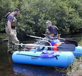 Picture of Ben and Chris preparing their kick boats for fishing