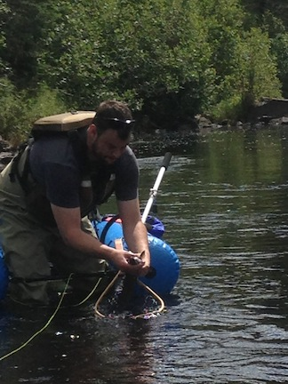 Picture of Ben picking up Brook Trout from the net