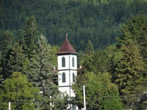 Picture of a white tower amidst green trees