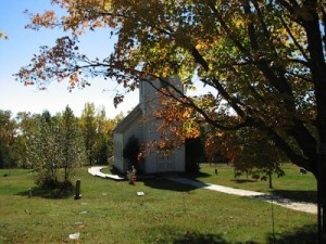Picture of Maple Hill Church surrounded by the changing leaves of fall