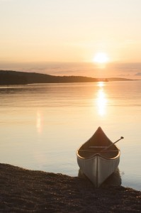 Picture of a canoe on the shore at sunset