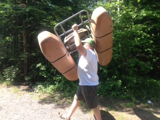 Picture of Chris carrying a kick boat