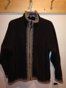 Picture of a brown full-zip Wintergreen top