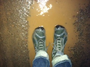 Picture of Jan's feet in TrekSta boots, standing in a puddle