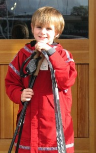 Picture of a young boy wearing a Wintergreen anorak and holding cross-country skis