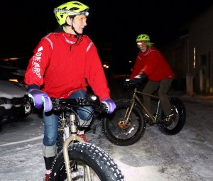 Picture of Jan and Tom riding the Surly Moonlander bikes at night