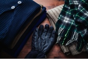 Picture of sweaters, scarves and gloves for a winter outdoor adventure