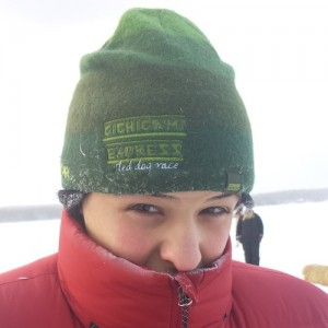 Picture of Jack's grandson wearing a Gichigami Express hat and a warm down jacket