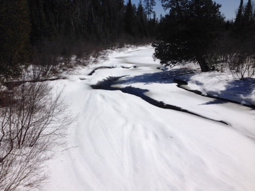 Picture of the Brule River. There is lots of snow, so you can barely see the river itself.