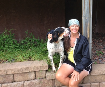Picture of Patch, an English Setter, licking Gail Lowe's face