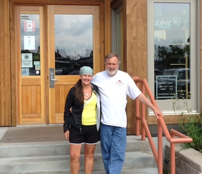 Picture of Gail Lowe and Jack standing outside of Stone Harbor Wilderness Supply