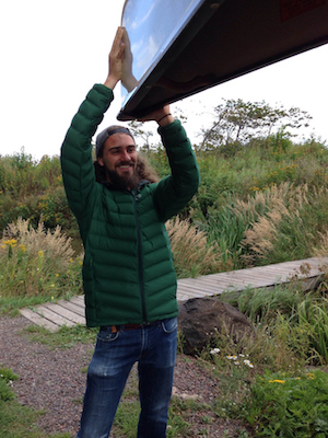 Picture of Josh easily lifting a canoe while wearing the Mountain Hardware Stretchdown Jacket