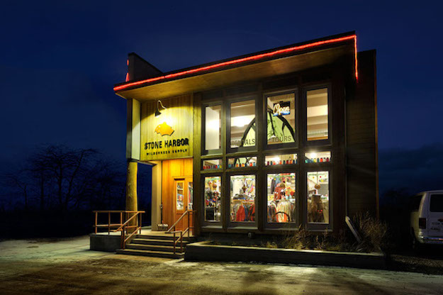 Exterior shot of Stone Harbor Wilderness Supply lit up on a winter night