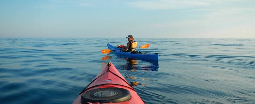 Picture of kayaker taken from the perspective of another kayak on Lake Superior