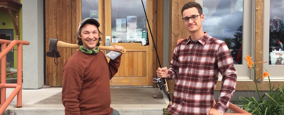 Picture of James and Danny standing in front of Stone Harbor Wilderness Supply and wearing the latest in fall fashions