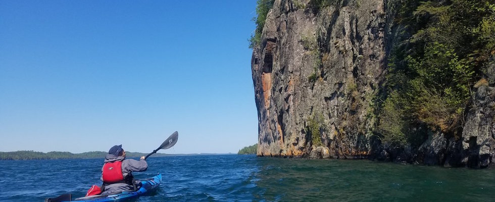 Picture of a kayaker on Little Trout Bay, Ontario