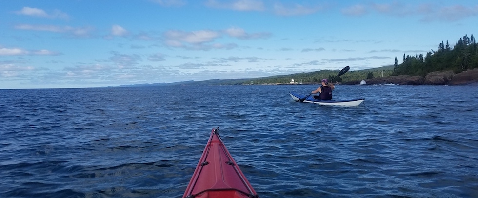 Picture of a kayaker taken from the bow of the instructor's kayak