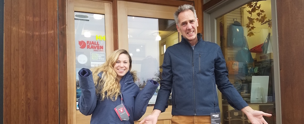 Picture of a short woman in a tall jacket and a tall man in a short jacket