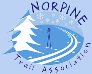 Norpine Trail Association, depicting a pine tree, with a cross-country ski trail and ski poles standing up in the middle
