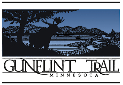 logo for Gunflint Trail, Minnesota, depicting a moose bu a tree with a lake in the background