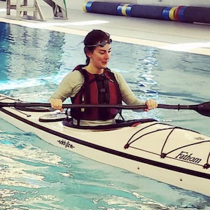 Picture of a woman practicing kayak safety skills in the Grand Marais YMCA pool