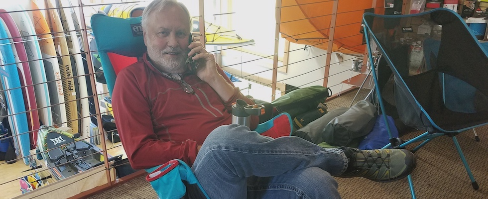 Picture of Jack lounging in an Eno lounger chair while he's talking on his cell phone