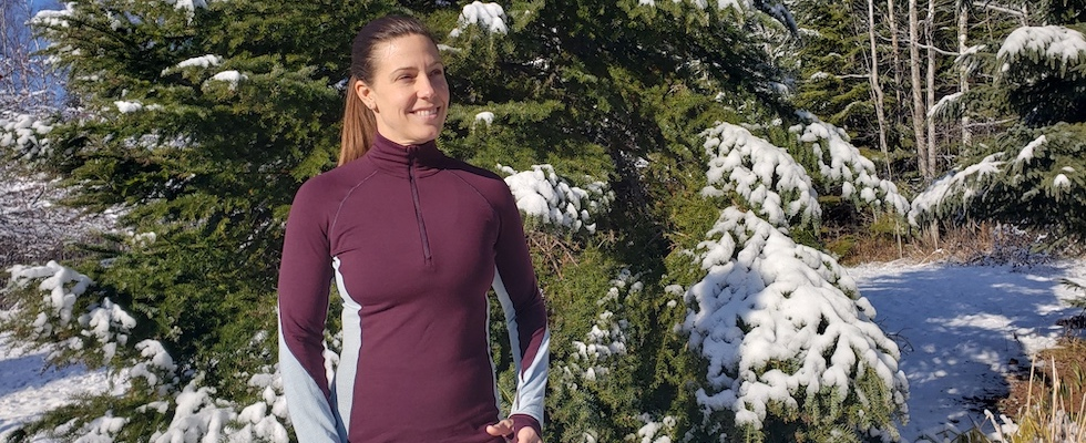 Picture of Beth in a plum and gray Icebreaker base layer