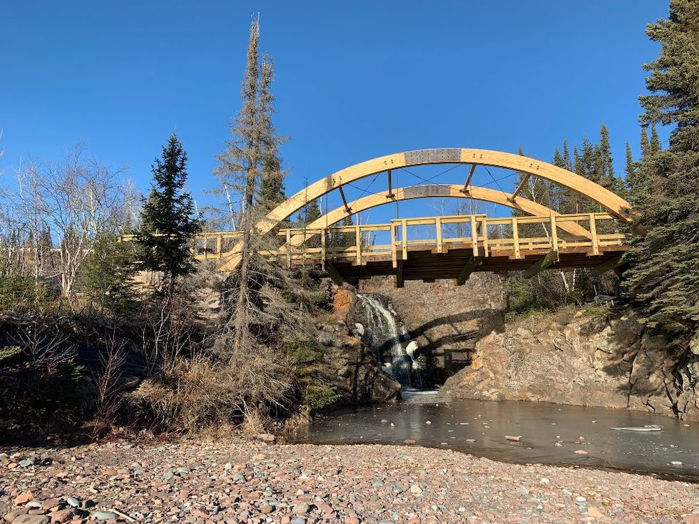 Picture of the bridge and the falls at Fall River on a bright day without a cloud in the sky