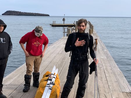 Picture of Ty talking on the dock at Grand Portage