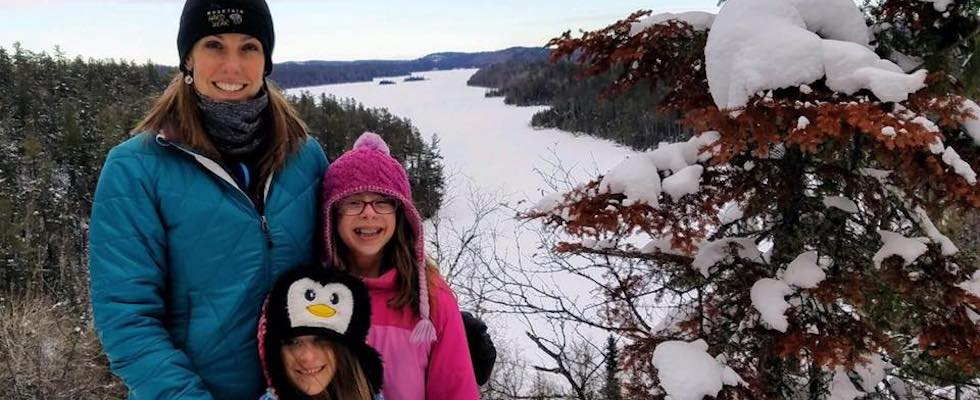 Picture of Beth hiking in winter with her two daughters